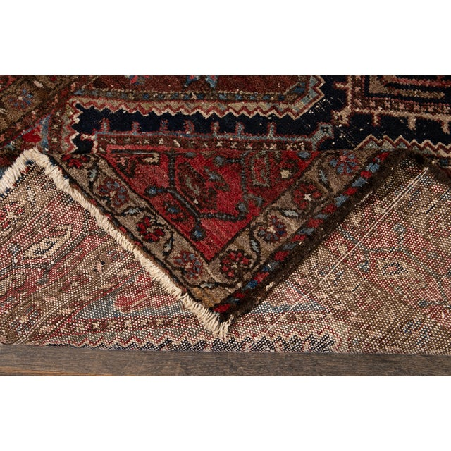 Beautiful Vintage Heriz rug with brownfield and multi-color accents in all-over multi medallion design. This rug measures:...