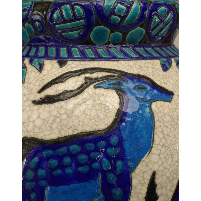Art Deco (Belgian) crackled earthenware vase with blue & green trim with deer & floral design (stamped Ch. Catteau./Boch...