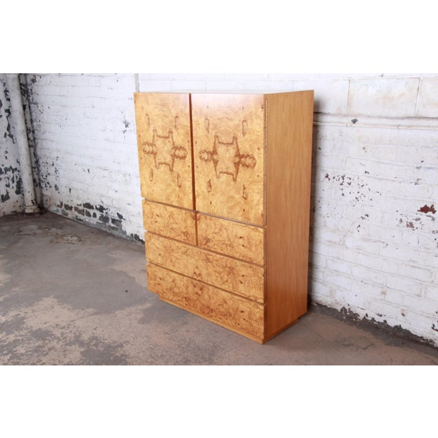 An outstanding mid-century modern burl wood gentleman's chest by Lane Furniture. The dresser features stunning burl wood...