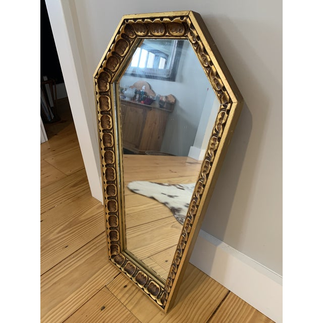 Unique vintage solid wood gothic coffin mirror. Wood is painted a beautiful gold with rubbed black accents. Eye catching...