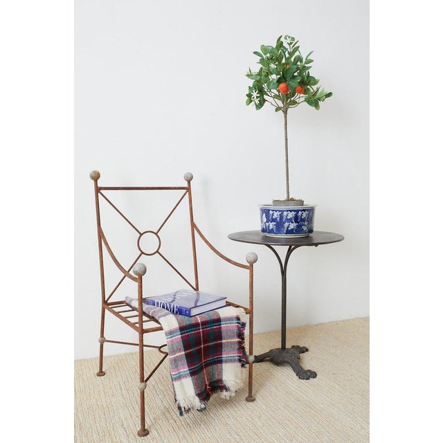 Unique set of six wrought iron patio and garden chairs made in the style and manner Mario Papperzini for Salterini. The...