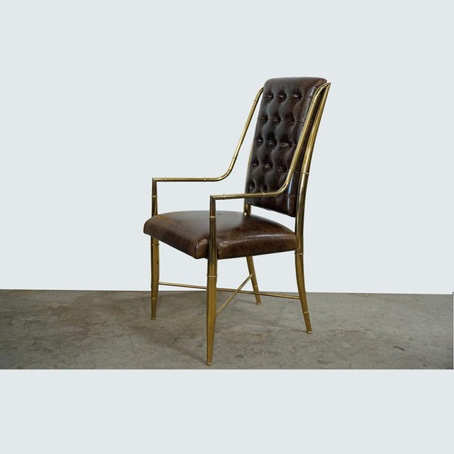 Faux Bamboo and Leather Dining Chair. Replica of the Mastercraft dining chair from the 70's. Distressed leather and...