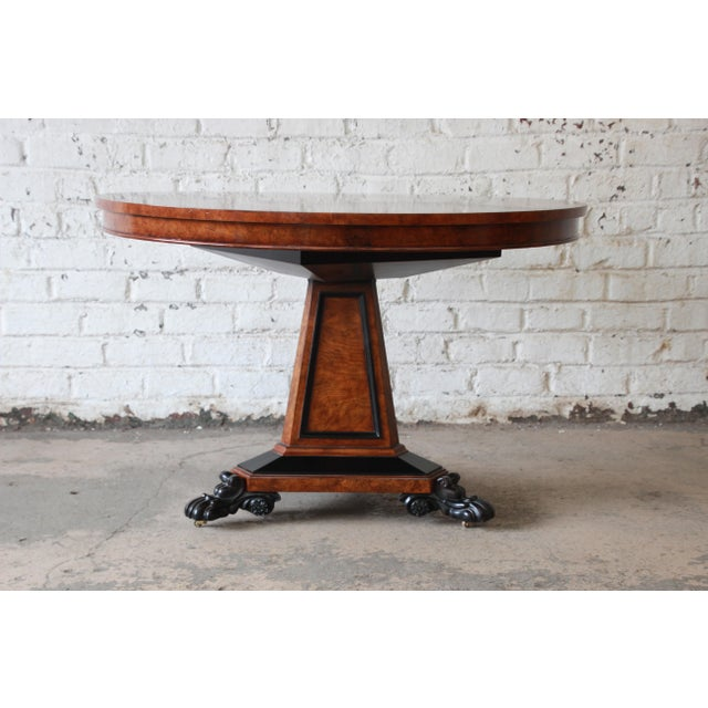 The Regency centre table, a rare piece, was designed in circular burl ash by George Bullock for Baker Furniture's Stately...