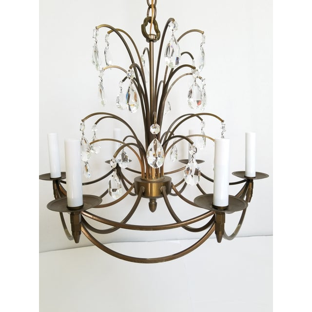 A vintage, circa 1960's brass Swedish chandelier in a bronze finish with 6 candelabra lights. Beautiful double faceted...
