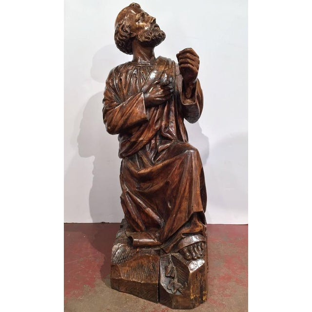 Beautifully carved antique walnut statue from a private chapel in France, circa 1760, featuring the apostle Simon Peter...