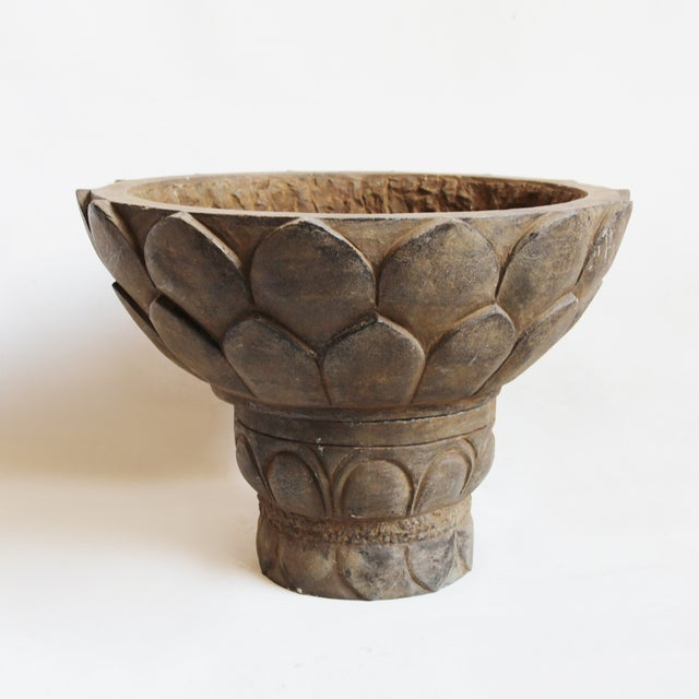 A pedestal base ensures that anything you place in this black stone Lotus bowl will become the main event (not to sway...