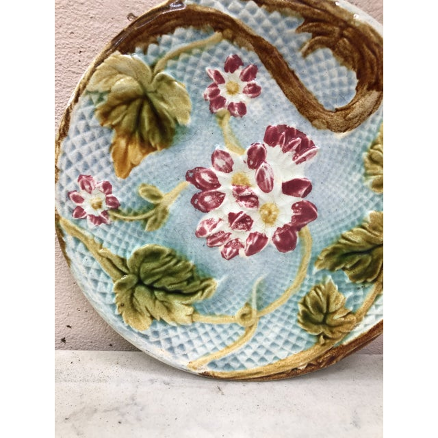 Lovely French Majolica plate pink flowers on a blue basket weave, circa 1880 attributed to Salins.