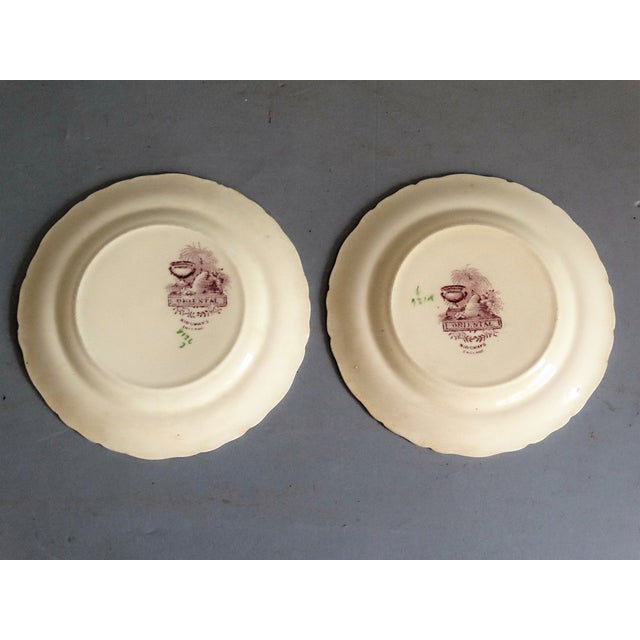 Late 19th-Century pair of Ridgways 'Oriental' pattern plates in mulberry color. They have a scalloped edge and retain...