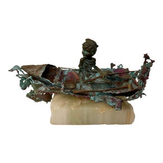 """1970s Boy in Boat Metal Sculpture Marked """"C Jere"""" For Sale"""