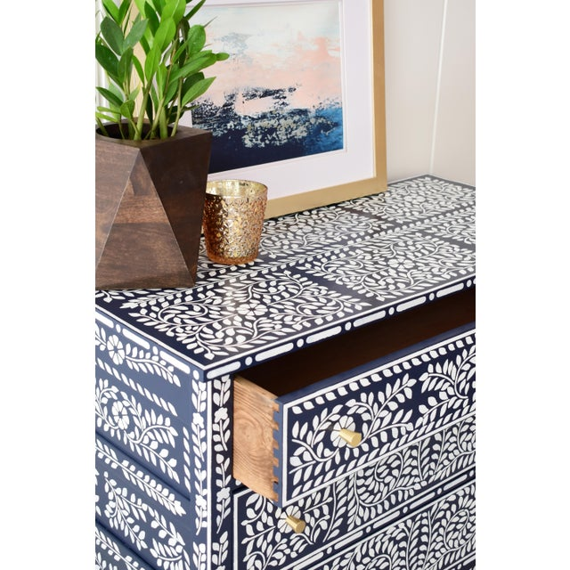Solid Oak Antique Dresser Painted in Navy and White with Faux Bone Inlay Stencil Design. Dresser has gold hardware and a...