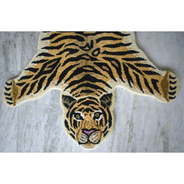 This is a whimsical rug in the shape of a Tiger. It is called a Persian hunting rug and they are often done with various...