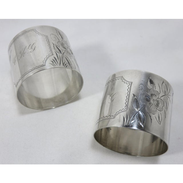 A Fine Quality Pair of Antique - Victorian Sterling Silver Wedding Napkin Rings. Hand engraved Floral Features - Each with...