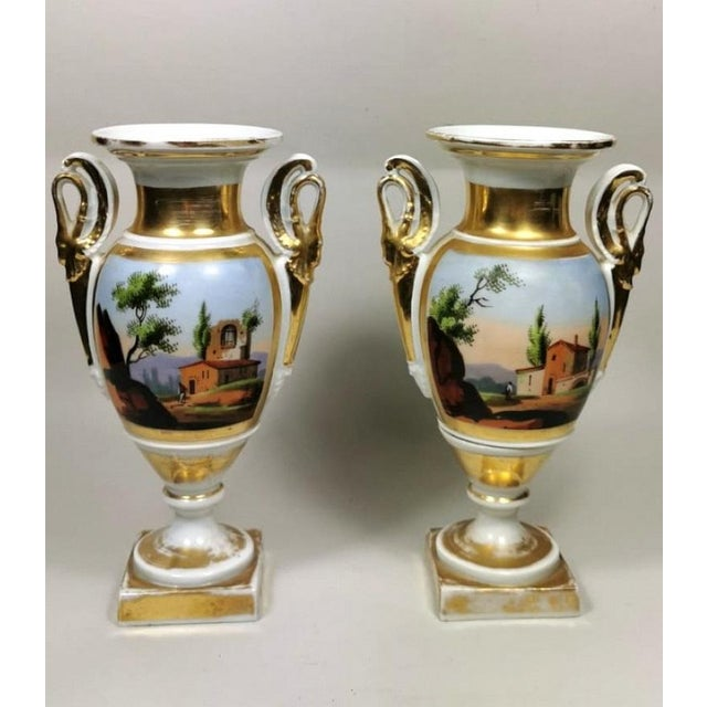 "Pair of antique vases in French porcelain ""Porcelain de Paris""; the delicate and colorful hand-painted decorations..."