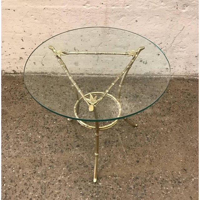 French bronze side table with a faux bamboo pattern and glass top.