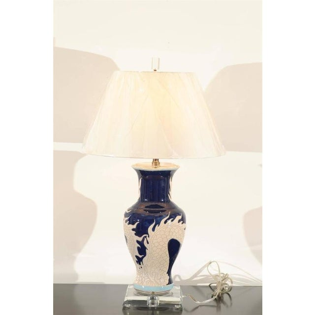 A stunning pair of vintage ceramic vases as lamps, circa 1940. Fabulous cobalt color with a beautiful, graphic cream...
