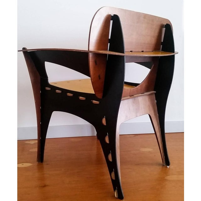 A stunning modern chair designed by David Kawecki, this plywood chair is a comfortable sitting chair as well as a...