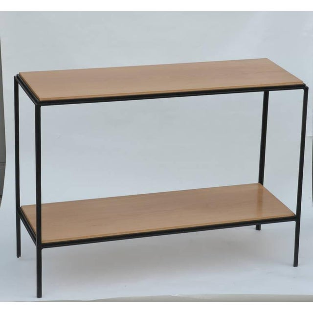Pair of chic wrought iron and oak 'Rectiligne' end tables by design Frères. Elegant, slender design. Second shelf is 6...