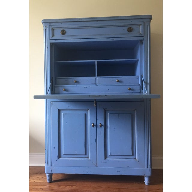 Vintage wooden secretary desk painted robin's egg blue and distressed. Features several drawers and cubbies with brass...