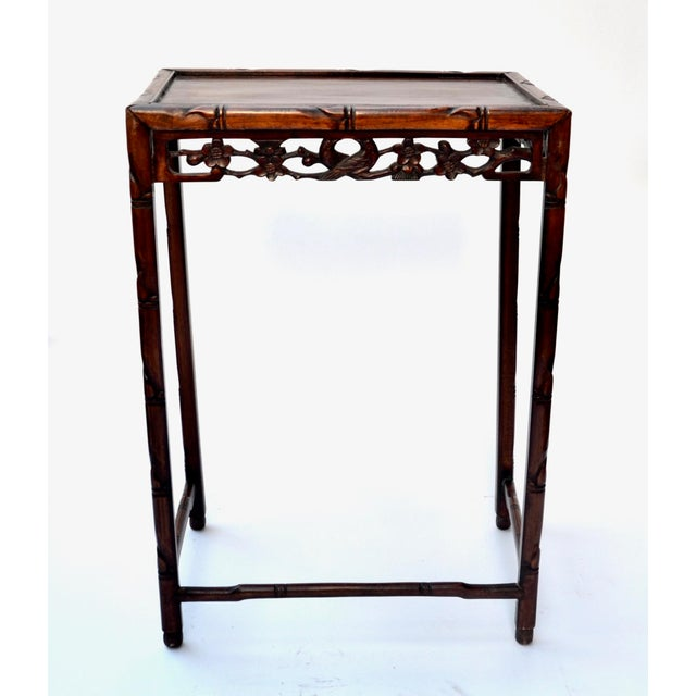 Lovely 19th century Chinese carved rosewood side table featuring intricate pierced friezes on all four sides, with faux...