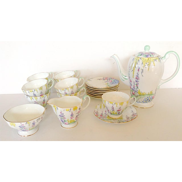 This English tea set for 8 is decorated like an English garden with hollyhocks, coral bells and wisteria. The set includes...