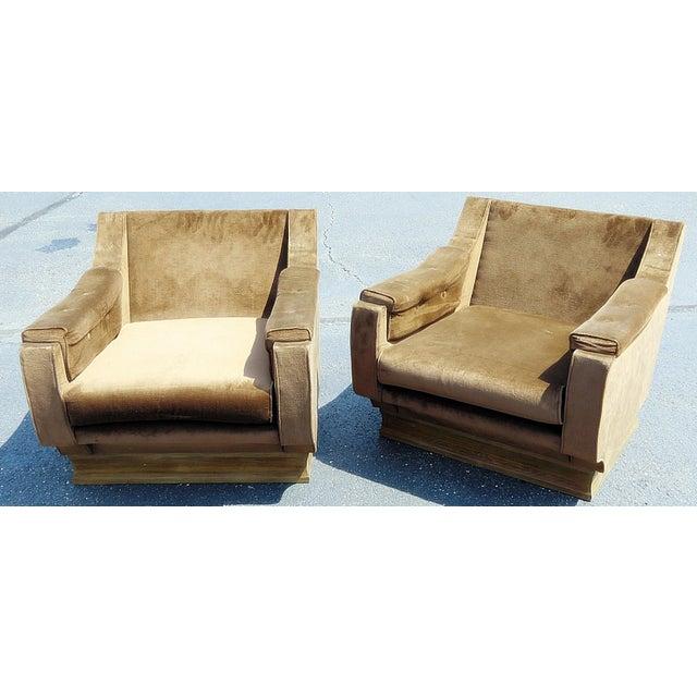 Pair of Italian Mid-Century Modern oversized lounge chairs.