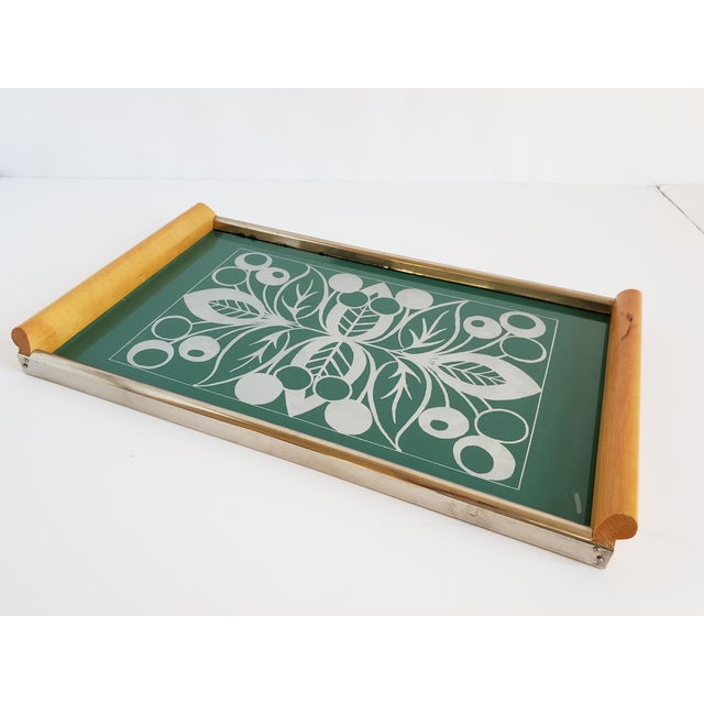 Mid Century Modern Scandinavian hot plate tray with teak wood handles and chrome edges. The tray has a beautiful Mid...