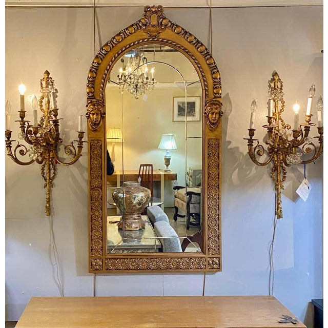 Pair of neoclassical wall or console mirrors. Giltwood pair of Italian wall or console mirrors each having a clear center...