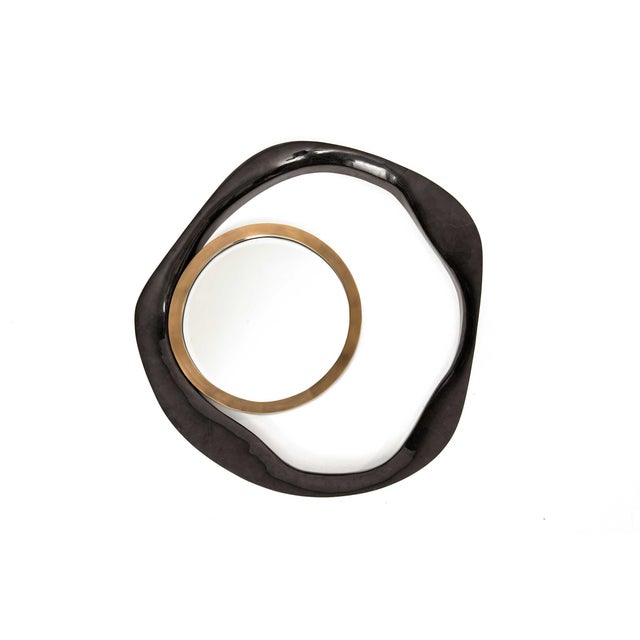 The Lily Mirror by R&Y Augousti in cream shagreen and bronze-patina brass, is an iconic piece of theirs and is an...