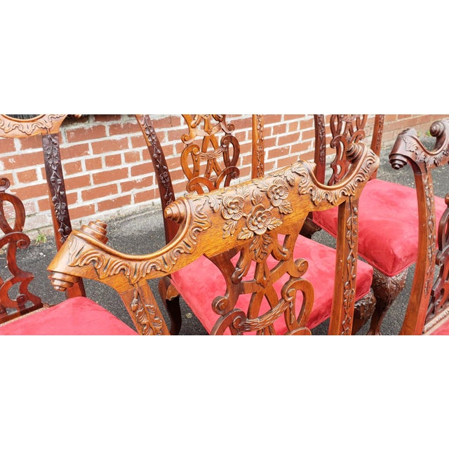 Description: This is a very attractive set of 6 heavily carved Chippendale style mahogany dining room side chairs,...