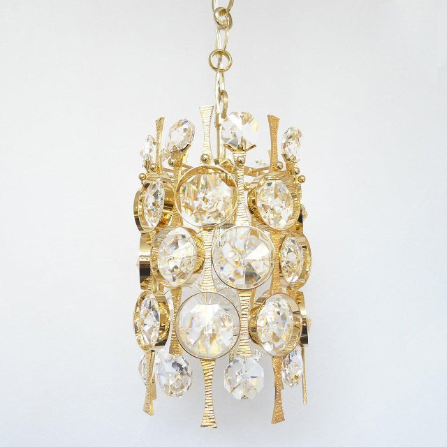 Mid-century ceiling pendant with gilded brass armature and rings surrounding round faceted crystals. In great vintage...