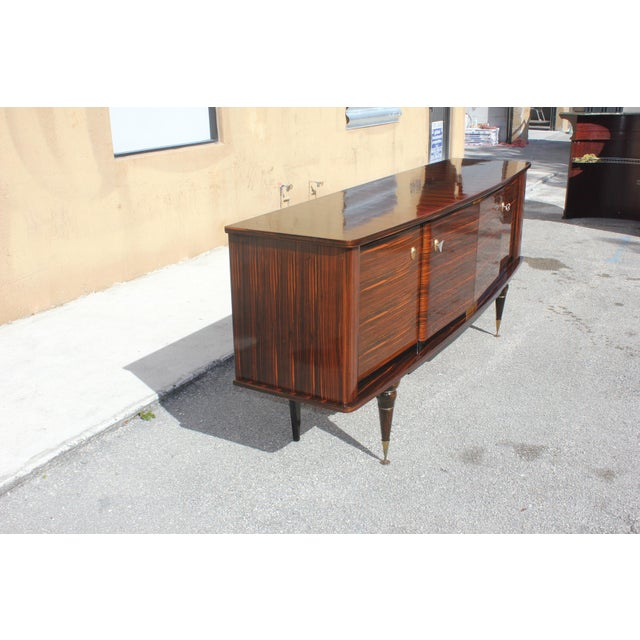 Beautiful French art deco exotic macassar ebony sideboard/buffet/bar, circa 1940s. The sideboard are in very good...