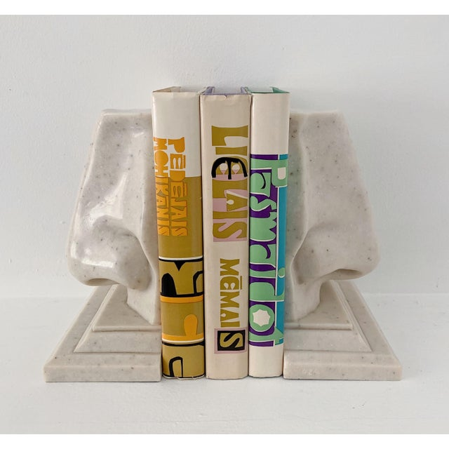 Vintage oversized nose faux marble bookends, circa 1970's in excellent condition.