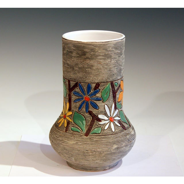 Vintage Italian pottery vase with wide band of blossoms incised into an all over combed texture. Attributed to Fratelli...