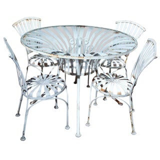 Vintage Set of Four Spring Chairs and Round Table For Sale