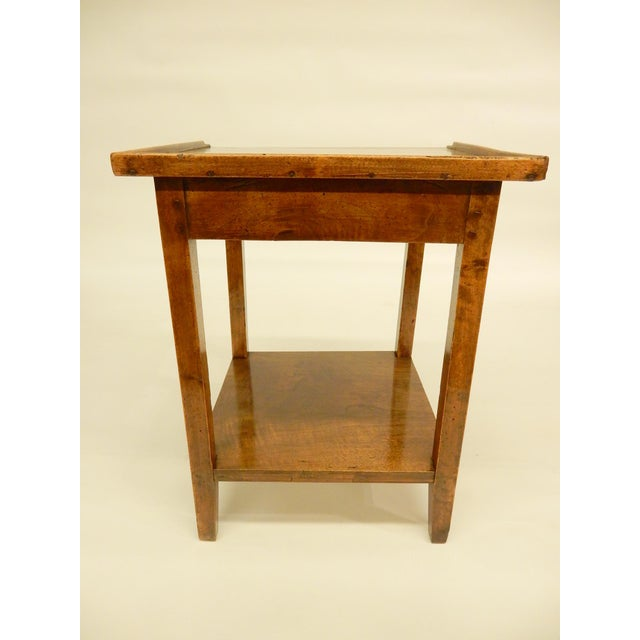 Carefully restored walnut side table with one drawer. It is structurally sound and in good condition.