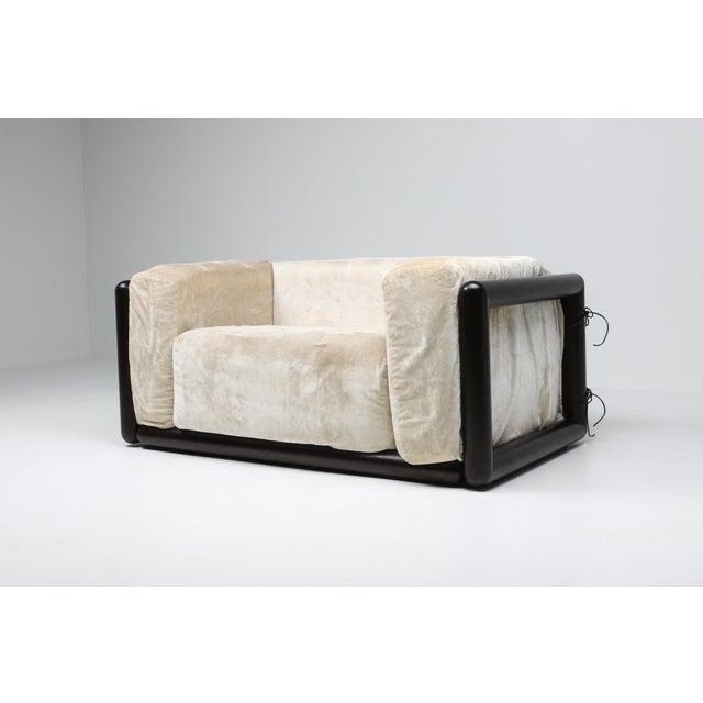 Post-modern loveseat chair by Carlo Scarp for Simon, Italy, 1973. off white original velvet upholstery, ebonized frame In...