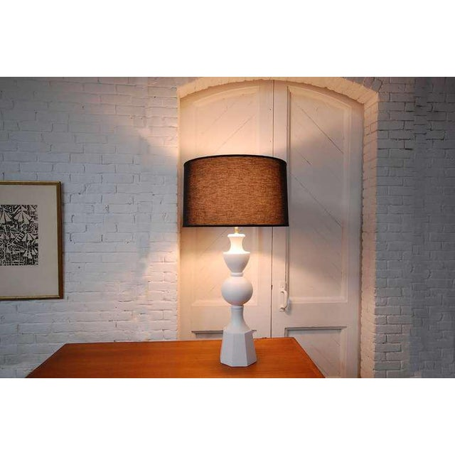 Large table lamp with very geometric shaped plaster body, with matte finish, and the highest quality solid brass hardware....
