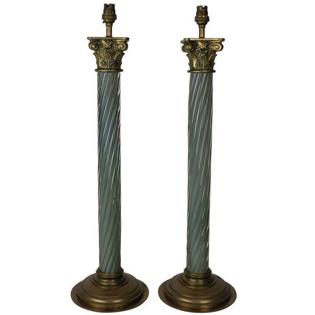 A pair of Russian table lamps in pale green barley twist glass with gilt brass fittings.