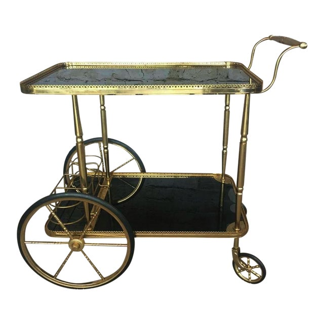 Hollywood Regency Maison Bagues Brass & Black Glass Tea Trolley For Sale