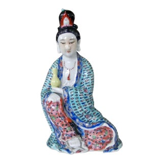 Mid-Century Chinese Famille Rose Handpainted Porcelain Sitting Lady Holding a Vase For Sale