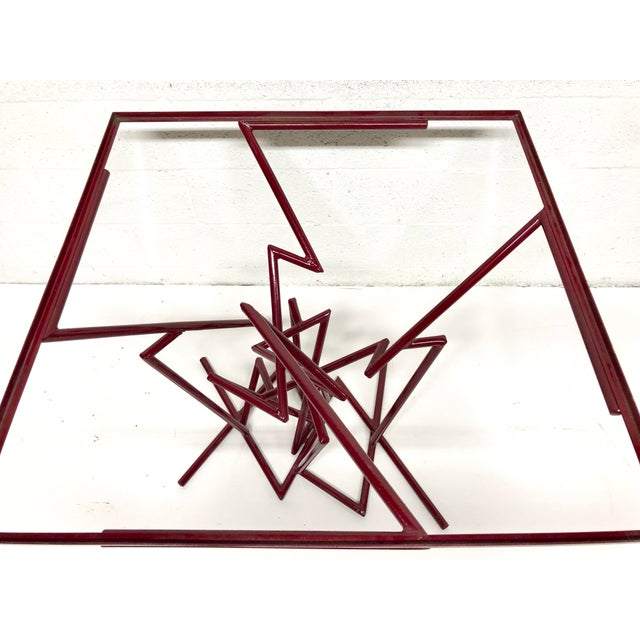 Unique sculptural metal table with glass top.