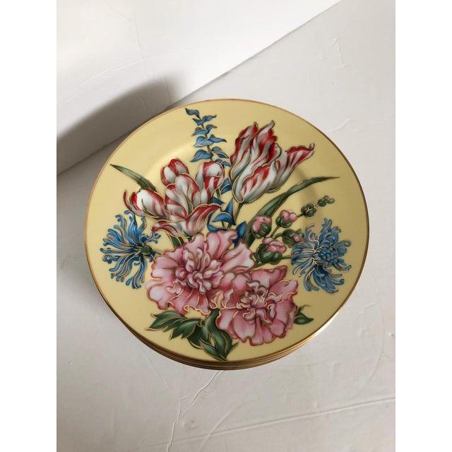 "Gorgeous set of seven Fitz and Floyd porcelain plates in the Joie des Fleurs pattern. Each, 7.5"" dia. x .75""H."