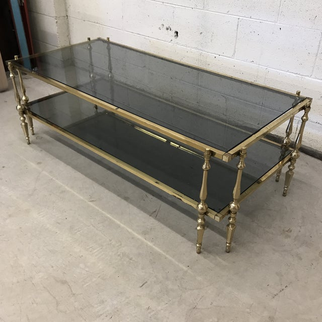 Beautiful brass and smoke glass two tier coffee table. Smoke glass is back, baby! While I was told this is Italian, I...