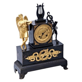 A 19th century French Empire Mantel Clock