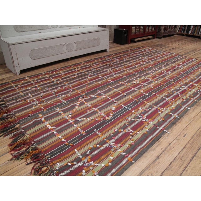 A tribal flatweave by Kurds of SE Turkey, intented as a hanging, tent divider, woven in four panels and decorated with...