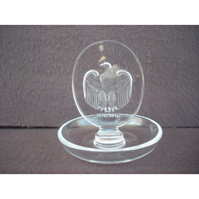"""Bicentennial Lalique ring holder; marked """"Lalique France"""" on the bottom; engraved frosted eagle with dates 1776-1976..."""
