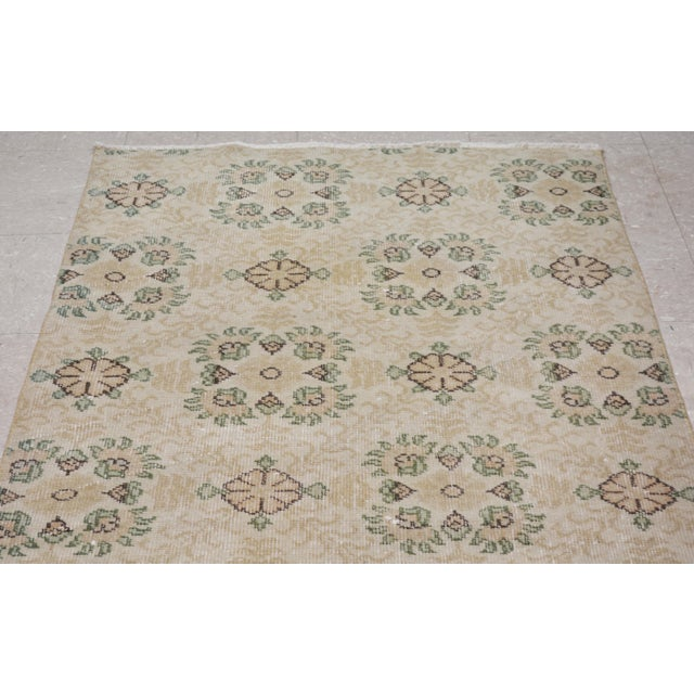 Vintage Turkish art deco handmade rug with natural colors and unique floral pattern.