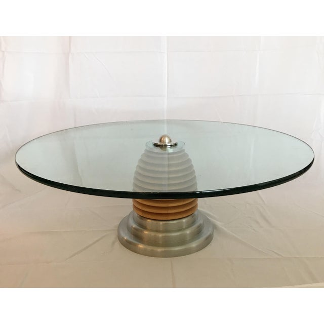 Two available. J. Wade Beam for Brueton futuristic style round wood and stainless steel coffee table. Table is in terrific...