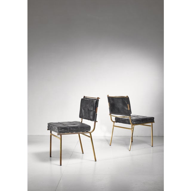 A rare and published pair of Mathieu Matégot chairs from the 1950s. The chairs are made of a brass frame with a black...