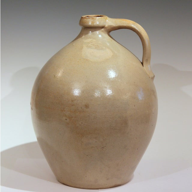 Nice early ovoid stoneware 3 gallon jug, circa early 19th century. Great form with warm and even color. Possibly New...